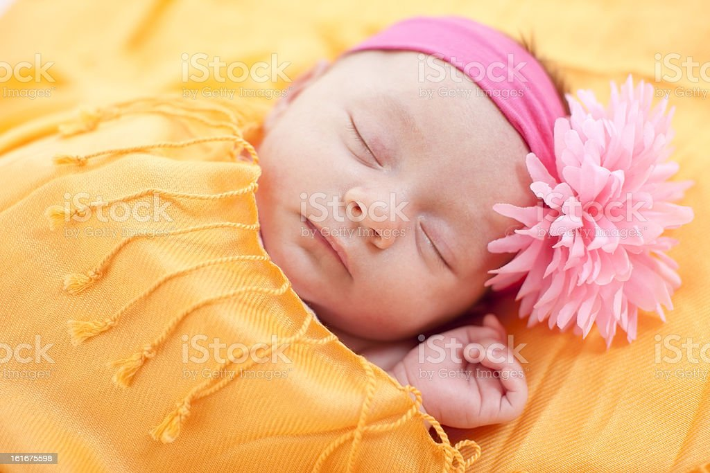 A head and shoulders image of a sleeping caucasian newborn baby girl....
