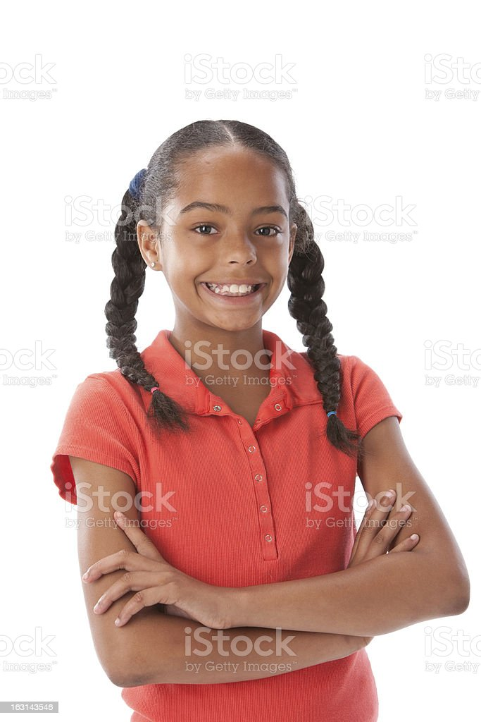 Real People: Smiling Black Little Girl Braids Arms Crossed stock photo