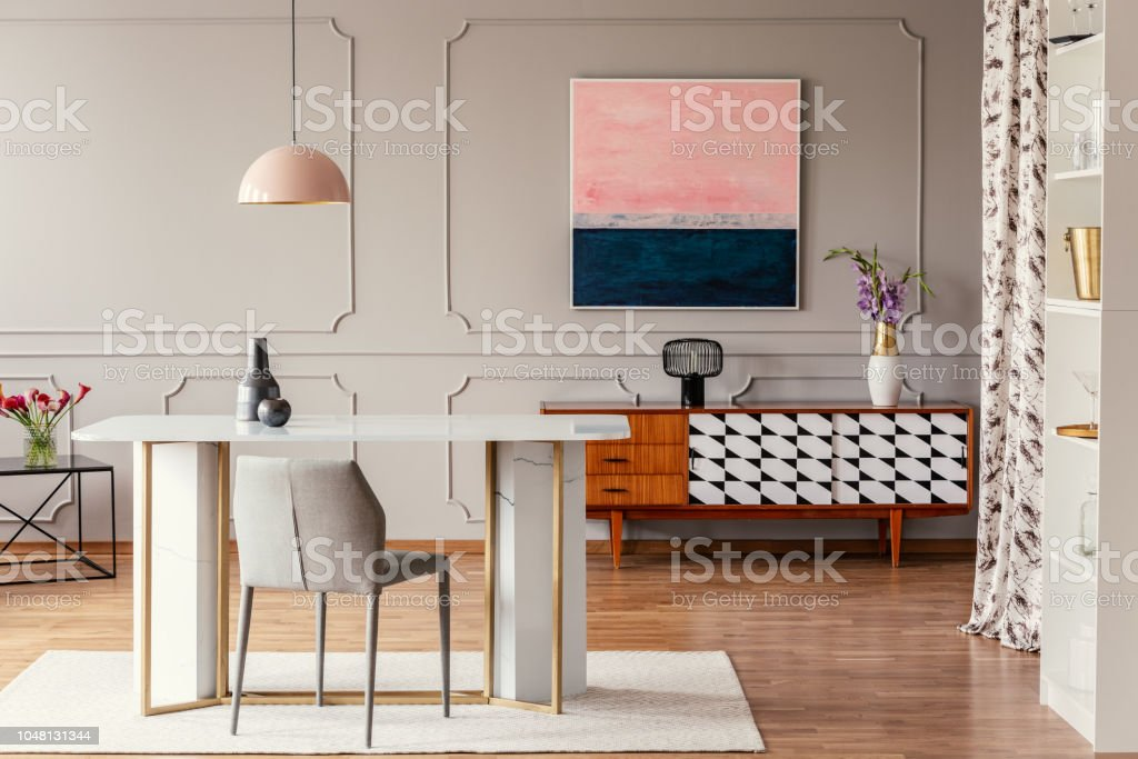 ... Pictures Of Apartment Real Photo Of A Dining Room Interior With A Table  Pink Painting And Vintage Cabinet Stock