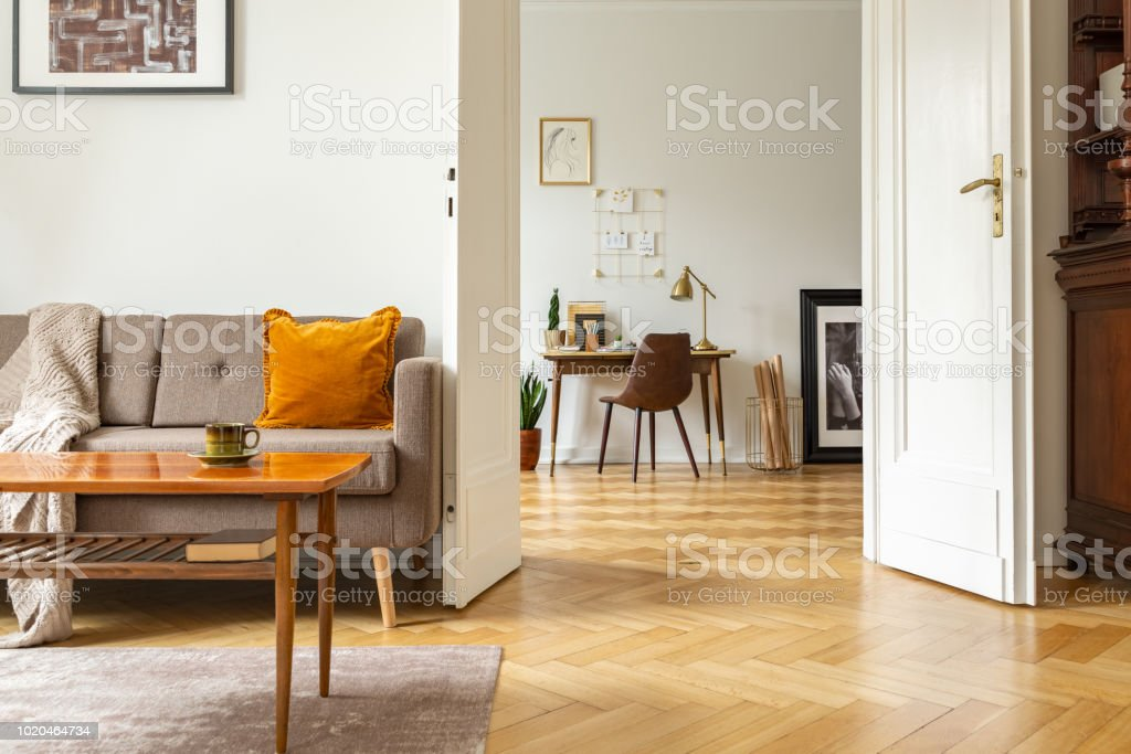 Real photo of a retro living room interior and view of a home office. View through a door royalty-free stock photo