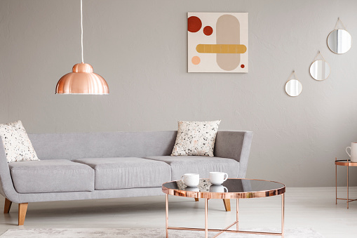 Real Photo Of A Simple Sofa Copper Lamp And Table And Painting On A Wall In A Living Room Interior Stock Photo More Pictures Of Chandelier