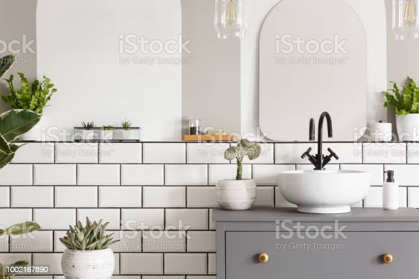 Real photo of a sink on a cupbaord in a bathroom interior with tiles picture id1002167890?b=1&k=6&m=1002167890&s=612x612&h=nrr78 3wzpmxzblkjjdn4kebgo3sa9vwj2lfndp5chc=