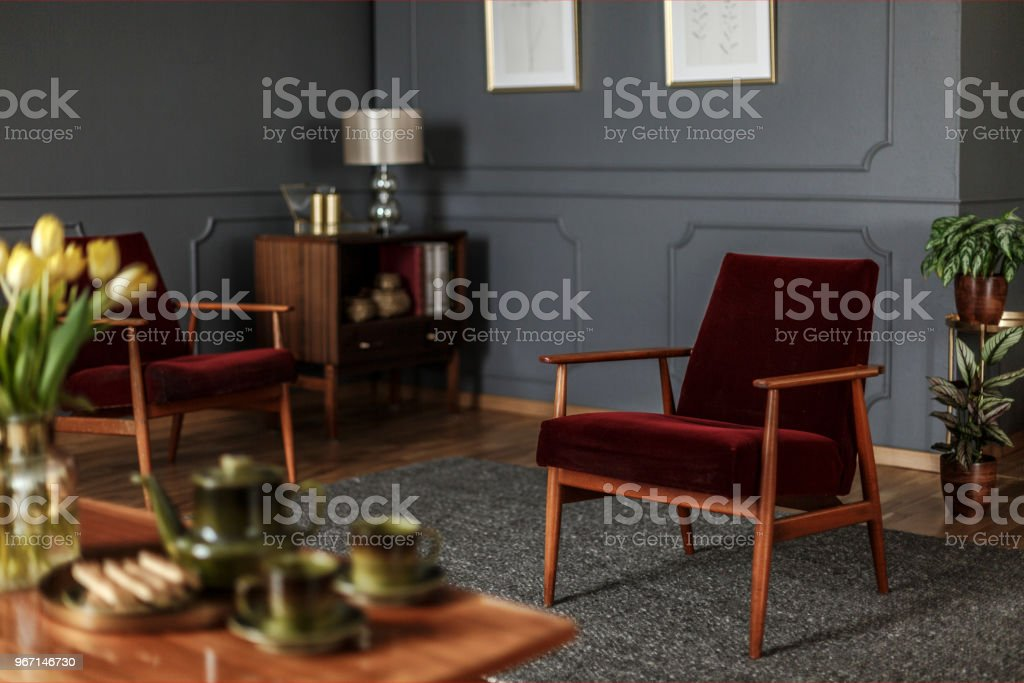 Real Photo Of A Wine Red Armchair Standing In The Middle Of An