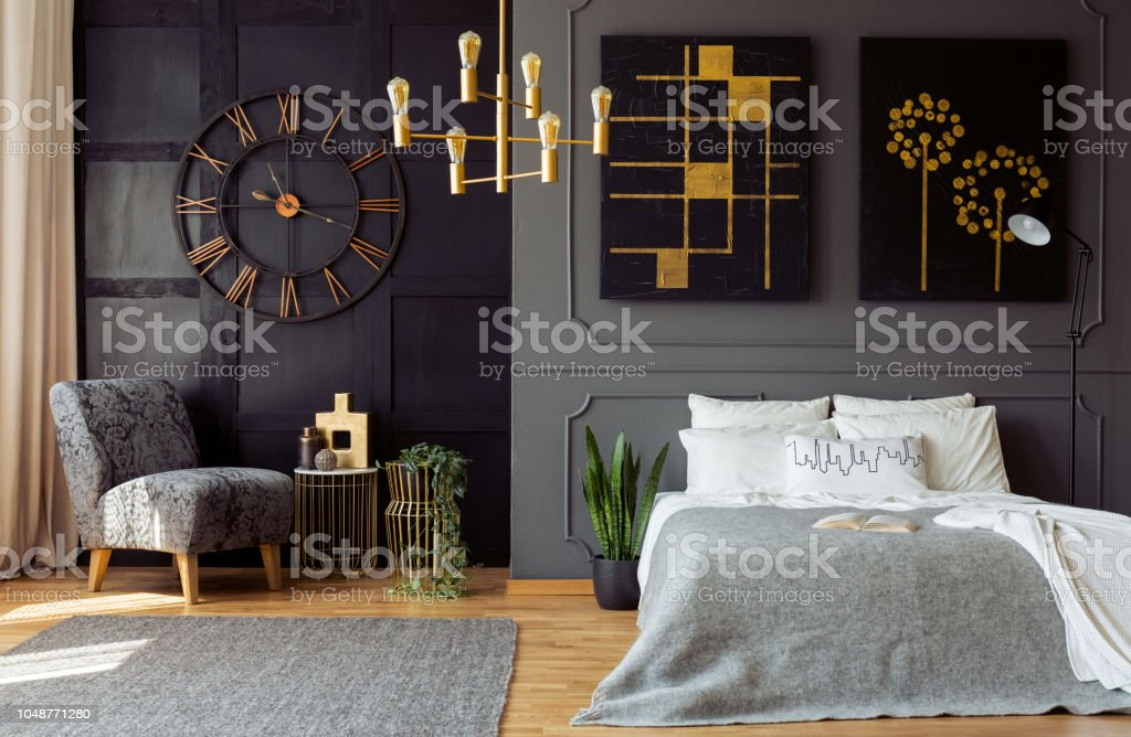Real Photo Of Dark Grey Bedroom Interior With Molding And Paintings On Walls Double Bed With Pillows Gold Lamp And Floral Armchair Stock Photo Download Image Now Istock