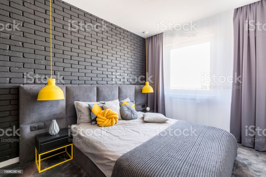 Real Photo Of Grey And Yellow Bedroom Interior With Window