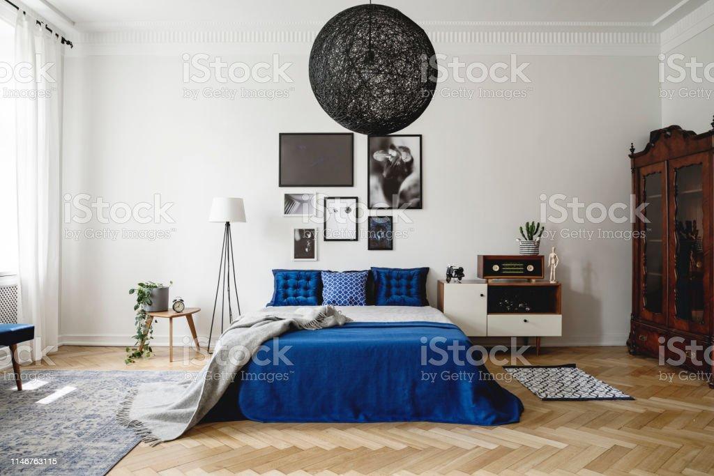 Real Photo Of Navy Blue Bedroom In Modern Condo Dark Wooden ...