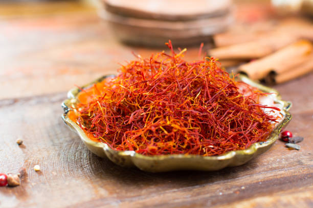 Real red dried saffron spice, tasty ingredient for many dishes Real red dried saffron spice, tasty ingredient for many dishes, close up saffron stock pictures, royalty-free photos & images