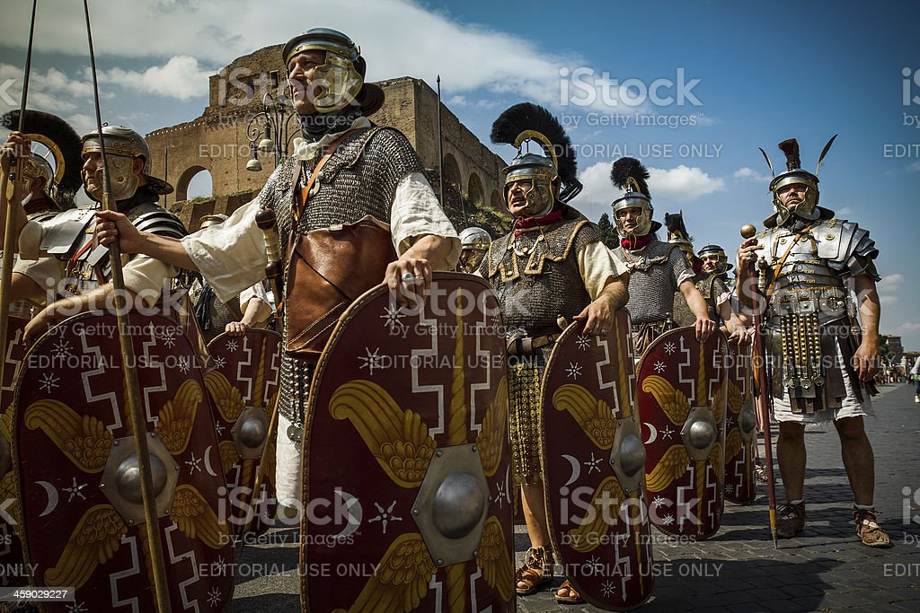 """Real Roman Gladiators and Centurions in front of the Coliseum """"Rome, Italy -  April 17, 2011: During a costume parade for the anniversary of the birth of Rome, also knowns as +amp;quot;Natale di Roma+amp;quot;, people dressed as gladiators walk in front of the Coliseum in Rome."""" Adult Stock Photo"""