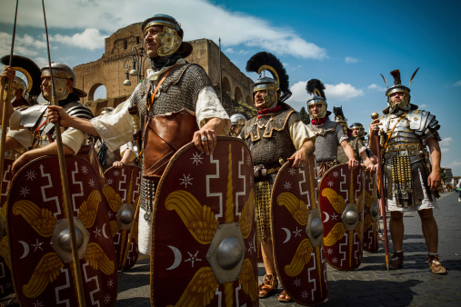 Real Roman Gladiators And Centurions In Front Of The Coliseum Stock Photo - Download Image Now