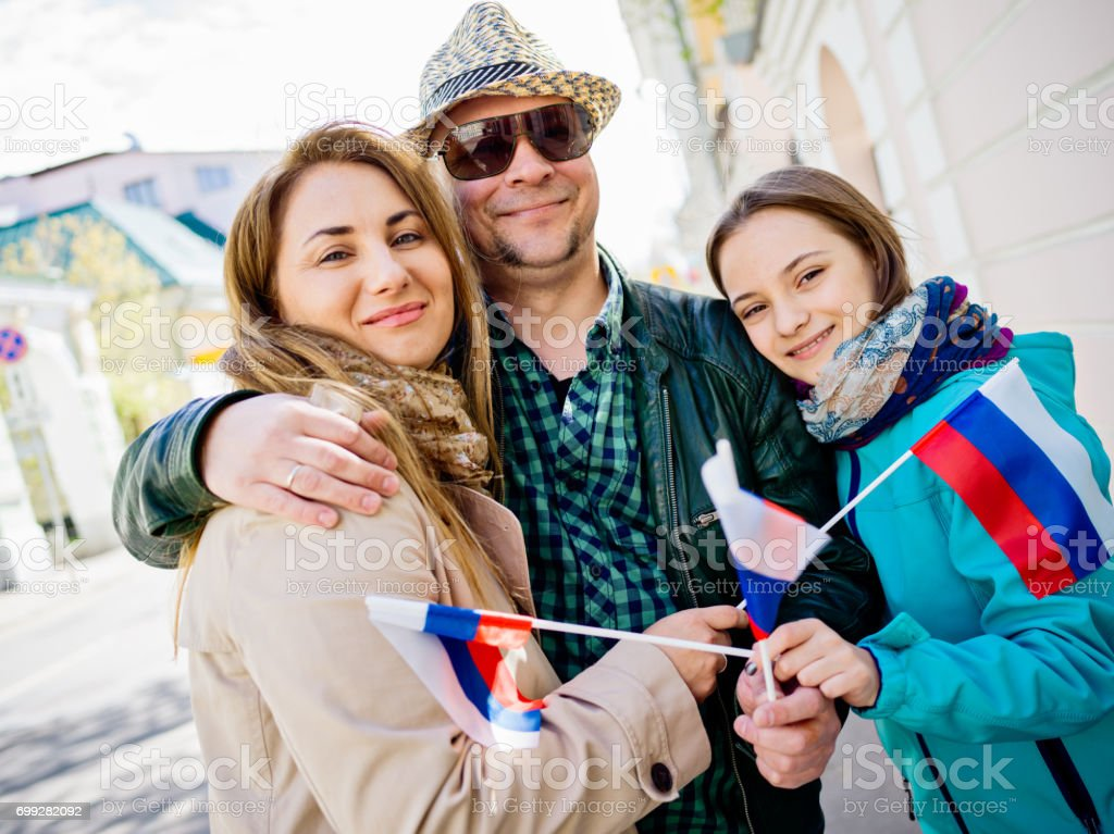 Real Russian family with National flags stock photo