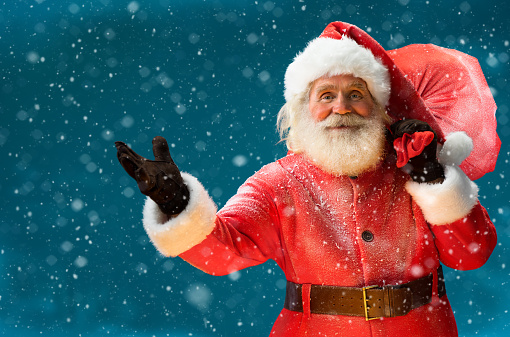 istock Real Santa Claus, carrying big bag full of gifts 501673714