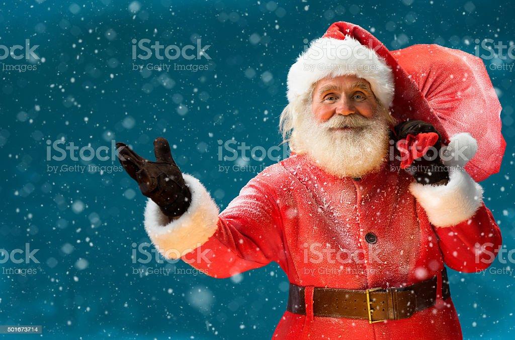 Real Santa Claus, carrying big bag full of gifts stock photo