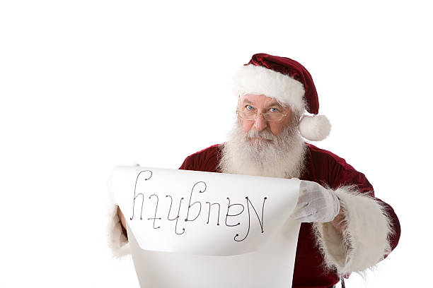 real santa claus on white reading naughty list copy space - mischief stock photos and pictures