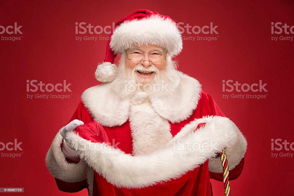Real Santa Claus opening gift bag stock photo
