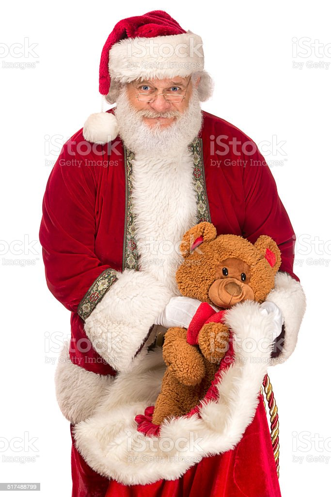 Real santa claus with toy teddy bear stock photo istock
