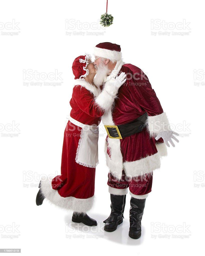 Real Santa Kisses Mrs. Claus Under the Mistletoe royalty-free stock photo