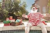 Real Santa Laughing by the Pool in Summer