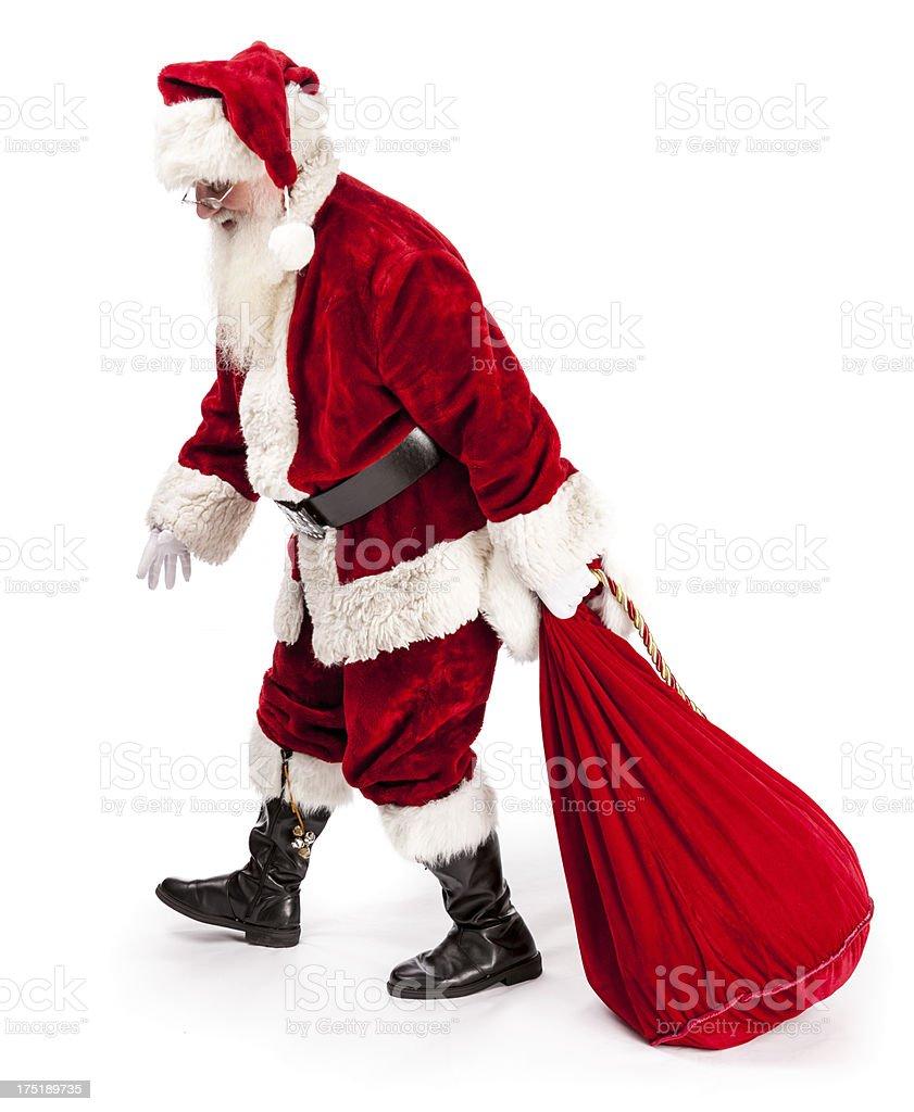 Real Santa Pulling Bag royalty-free stock photo
