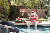 Real Santa Reading Letters by the Pool