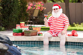 Real Santa Relaxing by the Pool
