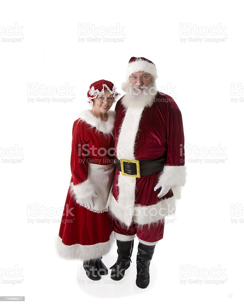 Real Santa with Arm Around Mrs. Claus on White stock photo
