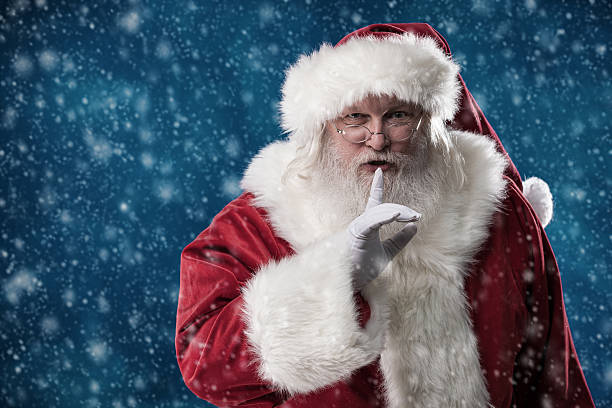 Real Santa With Finger to Lips stock photo