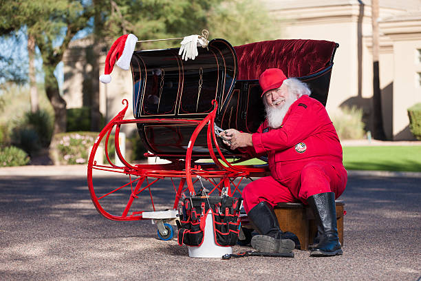 Real Santa Working on His Sleigh Real Santa Working on His Sleigh flight suit stock pictures, royalty-free photos & images