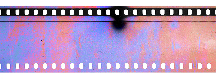 scanning light interferences on long filmstrip, dusty film texture