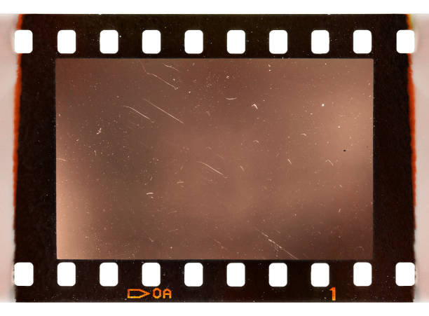 real scan of old 35mm filmstrip or photo frame with burned edges on white background - camera photographic equipment stock pictures, royalty-free photos & images