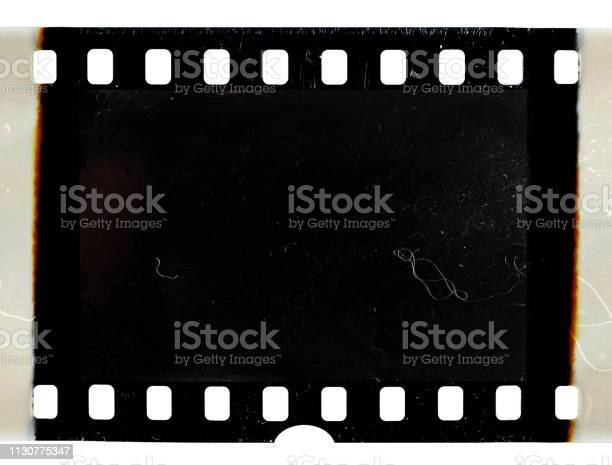 Real scan of old 35mm filmstrip or photo frame with burned edges on picture id1130775347?b=1&k=6&m=1130775347&s=612x612&h=dwxy1zc2ecym8ajoys dtkheold4k3qgevqk7ybsmi0=