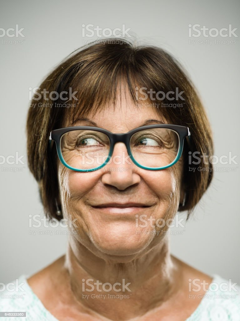 Real senior woman portrait looking away stock photo