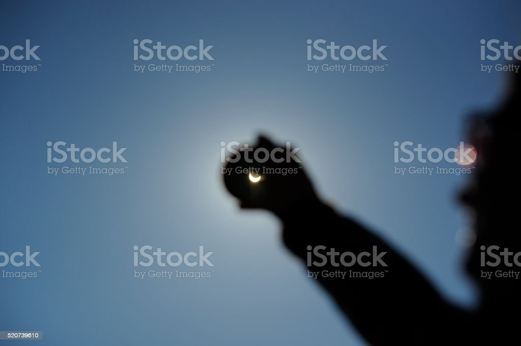 Real Solar Eclipse Seen Through Smoked Glass stock photo