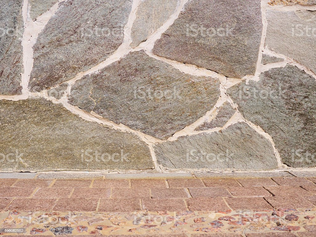 real stone wall surface with cement royalty-free stock photo