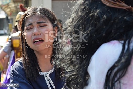 istock Real tears drop from the eyes of a woman feeling pity to Jesus Christ, street drama, community celebrates Good Friday representing the events that led to his Crucifixion 1146068331