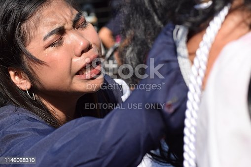 istock San Pablo City, Laguna, Philippines - April 19, 2019: Real tears emit from the eyes of a woman feeling pity to Jesus Christ, street drama, community celebrates Good Friday representing the events that led to his Crucifixion 1146068310