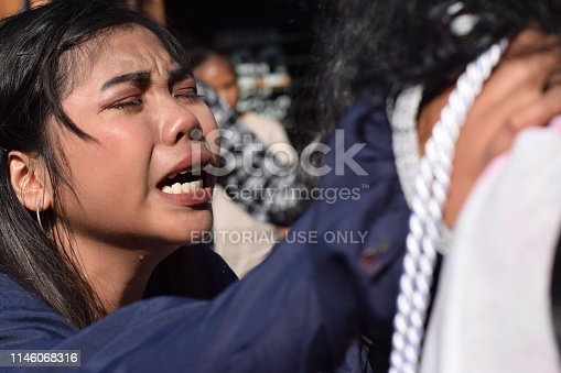 istock San Pablo City, Laguna, Philippines - April 19, 2019: Real tears emit from the eyes of a woman feeling pity to Jesus Christ, street drama, community celebrates Good Friday representing the events that led to his Crucifixion 1146068316