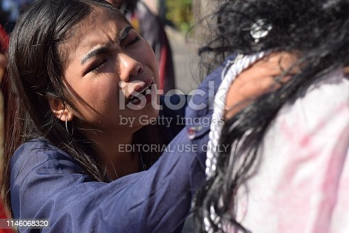 istock San Pablo City, Laguna, Philippines - April 19, 2019: Real tears emit from the eyes of a woman feeling pity to Jesus Christ, street drama, community celebrates Good Friday representing the events that led to his Crucifixion 1146068320