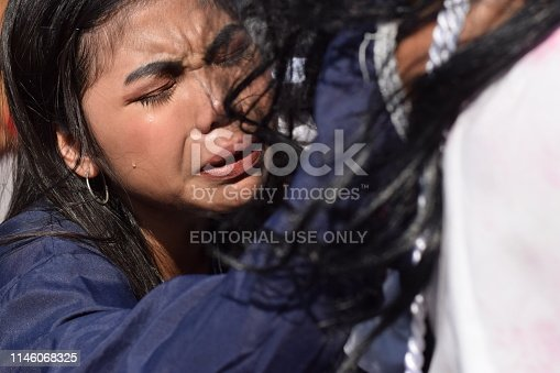 istock San Pablo City, Laguna, Philippines - April 19, 2019: Real tears emit from the eyes of a woman feeling pity to Jesus Christ, street drama, community celebrates Good Friday representing the events that led to his Crucifixion 1146068325