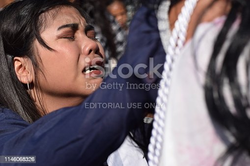 istock San Pablo City, Laguna, Philippines - April 19, 2019: Real tears emit from the eyes of a woman feeling pity to Jesus Christ, street drama, community celebrates Good Friday representing the events that led to his Crucifixion 1146068326
