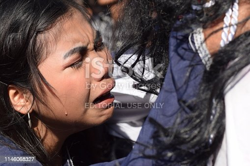 istock San Pablo City, Laguna, Philippines - April 19, 2019: Real tears emit from the eyes of a woman feeling pity to Jesus Christ, street drama, community celebrates Good Friday representing the events that led to his Crucifixion 1146068327