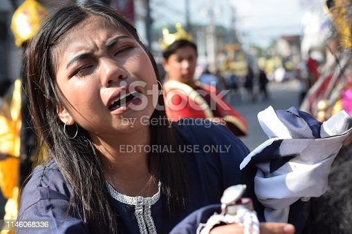 istock San Pablo City, Laguna, Philippines - April 19, 2019: Real tears emit from the eyes of a woman feeling pity to Jesus Christ, street drama, community celebrates Good Friday representing the events that led to his Crucifixion 1146068336