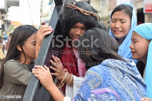 istock Real tears emit from the eyes of women feeling pity to Jesus Christ, street drama, community celebrates Good Friday representing the events that led to his Crucifixion 1146067308