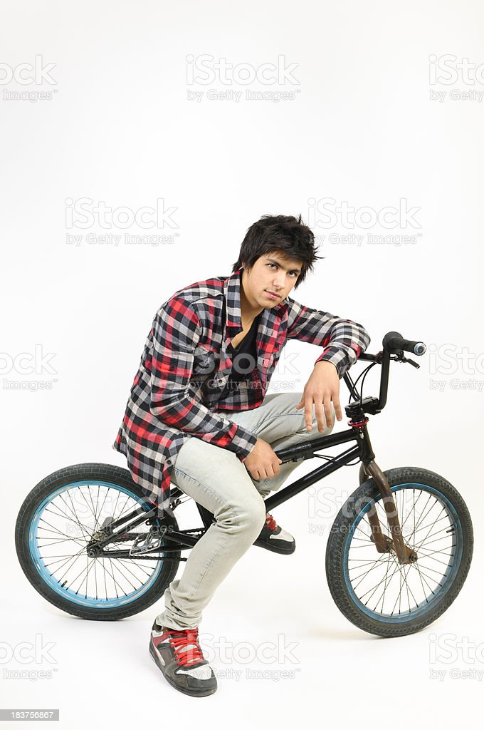 Real teenager with his BMX bike stock photo