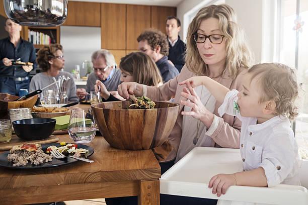 real three generations family big dinner at home. - kinderstuhl und tisch stock-fotos und bilder