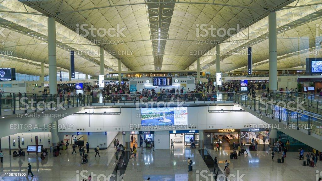 Hong Kong - 12 June, 2019 People waiting at Arrival Hall in Hong Kong...