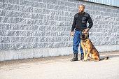 A real, trained K-9 handler with his dog