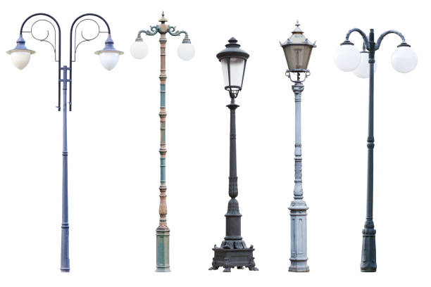 Real vintage street lamp posts and lanterns isolated on white background stock photo