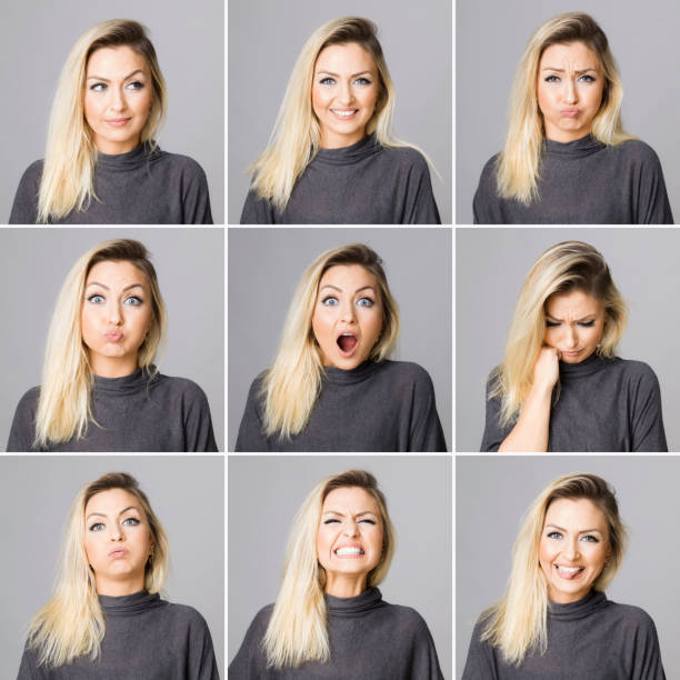 Real woman making different facial expressions stock photo