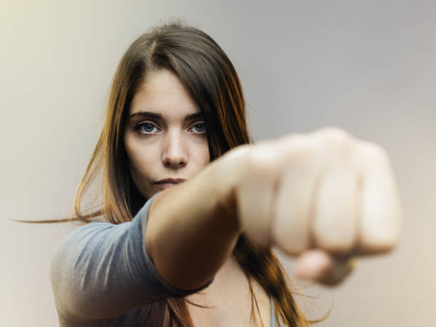 real woman ready for fight - punching stock photos and pictures