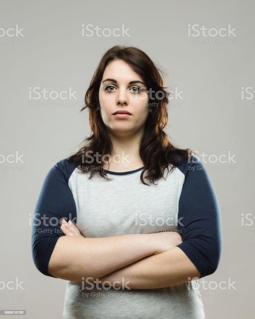 Real woman standing with her arms crossed stock photo